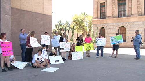 Reaction to SB 1062, a bill to let businesses cite religious belief as a defense against discrimination charges, has drawn protesters to the Capitol and led one Tucson pizzeria to threaten to refuse service to lawmakers. <b>Cronkite NewsWatch</b> has team coverage.